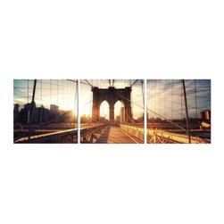 Elementem - Brooklyn Sunset Wall Art | Elementem - Design by Elementem Photography. Brooklyn Sunset's iconic perspective shot, the dramatic colors, and the backdrop of New York City create an amazing blend of harmony that is difficult to describe. A rare moment of New York serenity is captured in Brooklyn Sunset, a moment that can be experienced over and over when looking at the artwork. Brooklyn Sunset is digitally printed on vinyl then mounted onto solid wooden MDF frames and covered with a thin layer of laminate that allows the print to be easily cleaned with Windex and water. All the wall hanging materials needed for installation are provided. Suitable for contract projects. Available in three size formats.Elementem Photography is a proud member of 1 Percent for the Planet, a group of businesses that have committed to donating 1 percent of their sales towards environmental causes.