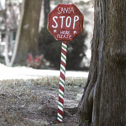 STOP SIGN FOR SANTA - NEW - How else will Santa know where to drop off the presents? This adorable hand-painted sign is a great way to reassure the kids that Santa will indeed be stopping by, and its brightly striped base looks great in a yard or even propped up in a corner inside.