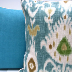 Turquoise Ikat pillow - This heavy-upholstery-weight basket weave Ikat has a beautiful soft texture. It has a Catalina spa-like color palette with shades of oatmeal, sand, mossy green and a stunning rich turquoise-marina blue background. This tranquil pillow will compliment a spa like setting whether it be your living room, atrium, or bedroom.
