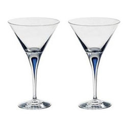 """Orrefors - Intermezzo Blue 7 oz. Martini Glass (Set of 2) - The Intermezzo collection of glasses, each with an eye-catching blue drop suspended in the stem, has won the hearts of critics and consumers alike. In 1985, Orrefors won the International Tabletop Design Award for this stunning design. Features: -Martini glasses (Set of 2). -Complements the Intermezzo collection. -Beautiful and modern design. -Each with an eye-catching blue drop suspended in the stem. Specifications: -Dimensions: 6.75"""" H x 4.38"""" W. -Capacity: 7 oz.. -Material: Crystal. -Hand wash recommended. Please Note: As this item is made individually by hand when you place your order, variations in color, shape, size, and pattern may occur. Aesthetic variations are at the discretion of the artist. Also, due to the nature of the raw materials used, this product may look dramatically different depending on the color, quality, and amount of light present in its environment and on the coloration of surrounding objects. California's Proposition 65: California's Proposition 65 entitles California consumers to proper warnings for products that contain chemicals known to the state of California to cause cancer and birth defects, or other reproductive harm, if those products expose consumers to such chemicals above certain levels. While most products sold on our site comply with California Proposition 65, your safety is very important to us, so we hope that the following information will help you with your purchasing decisions. The general Proposition 65 notice is as follows: WARNING: This product contains chemicals known to the State of California to cause cancer and birth defects or other reproductive harm. In addition, the following separate notice applies to leaded crystal glassware: WARNING: Consuming foods or beverages that have been kept or served in leaded crystal products will expose you to lead, a chemical known to the State of California to cause birth defects or other reproductive harm."""