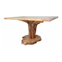 Crafted Woods - Ancient Bristlecone Kitchen Table - Our Beautiful one of a kind Kitchen Table is truly unique!  We used the base of a tree, flipped it upside down so the roots would support the top, added a large vertical cut slab for the base then added small stumps to support the entire piece.  The top is from one tree that was horizontally cut to form large slabs.  This piece is sure to a conversation piece in your home.