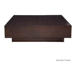 Nuevo Living - Dumas Coffee Table, Dark Walnut Veneer - This chunky, low-profile platform coffee table has the width and weightiness to carry all kinds of stuff on top, from stacks of books to large floral arrangements, while still keeping everything on the down-low. The look is solid and down to earth (literally), yet it magically opens up your space for an overall lighter feel. You even get two hidden side drawers for extra storage.