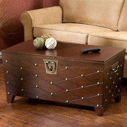 Upton Home - Nailhead Espresso Cocktail Table Trunk - This cocktail table features a deep espresso finish and a unique contemporary nailhead design. The table would be a elegant accent piece for your living space.