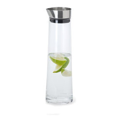 Blomus - Acqua 1 L Water Carafe - Hand blown glass. Capacity: 1 L. Made of glass and stainless steel. Designed by Floz Design. 1-Year manufacturer's defect warranty. 3.54 in. Dia. x 12 in. H