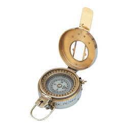 Handcrafted Nautical Decor - Brass Engineers Compass 5'' - This Hampton Nautical Solid Brass Engineering Lensatic Compass is available in a polished brass finish. The compass card has the standard 0 - 360 degree scale, as well as the 0 - 64 Mil scale (one yard at 1,000 yards). The cardinal points are luminous for easy viewing in the dark, and the compass features a standard glass bezel with two lines at 45-degree angles. The bezel also rotates with detents so you can change the heading reference a known amount without looking at the compass. The front sight has a magnifier to simultaneously view the magnetic heading when taking a sight. Folding the sight down operates a needle lift mechanism to protect the compass bearing. On the side of the compass is a needle freeze mechanism to hold a reading. --The lid of the compass has a glass window with a line etched into the glass for use as a rear sight. The outside of the compass has a brass guard to protect the glass. The back of the compass can be custom engraved with a minimum quantity purchase. --A wooden box is included with the compass. ------    Polished brass housing for compass--    Luminous face cardinal points glow in the      dark--    Rotating dial with detents for taking      accurate bearings--    Dual scales marked 0-360 degrees and 0-64      mils--    Needle lift automatically operates to      protect bearing--    Lensatic site for precise readings--    Handcrafted      leather case to      store compass--    Custom engraving available on large quantity      orders (call us for information)----