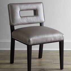 """Old Hickory Tannery - Sue Ann Dining Chair - LIGHT GREY - Old Hickory TannerySue Ann Dining ChairDetailsEXCLUSIVELY OURS.Dining chair with cut-out back.Maple frame with coffee bean finish.Leather upholstery.Nailhead trim.20.5""""W x 24""""D x 32.5""""T. Made in the USA.Boxed weight approximately 50 lbs. Please note that this item may require additional delivery and processing charges.Designer About Old Hickory TanneryFounded more than 30 years ago Old Hickory Tannery is still family owned and operated in Hickory North Carolina. Although the company's name reflects its original focus on fine leather upholstery Old Hickory is now equally well know for fabric-covered seating. Its range of styles is impressive from dramatic Duncan-Phyfe-style sofas to graceful Queen Anne armchairs claw-footed tub chairs feminine full-skirted settees and sleek slipper chairs. Old Hickory's craftsmen bring an abundance of expertise to their work; some have been making furniture for almost half a century. All upholstery is cut and sewn entirely by hand all frames are solid hardwood nailhead trim is hand-hammered and all springs are hand-tied to the frame and surrounding springs at eight points for lasting comfort and stability. These are just a few of the reasons why this American furniture maker is one of our favorites."""