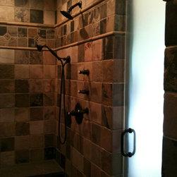 Frameless Shower Door - Single frameless shower door using oil rubbed bronze hardware, acid etched glass.