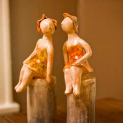 Mathews & Company - Best Friends Set of 2 - Best Friends Set of 2- These beautiful friends are sitting atop two cylindrical perches, and leaning towards each other as if sharing a secret. Skilled artisans have captured the essence and beauty of friendship in this set. They can either be shared by best friends, a beautiful reminder of their friendship, or placed together on a shelf, fireplace or console table as a pair. Their beautiful porcelain legs are bare, and the dresses and hats that they adorn are in warm, fiery tones that will blend well with any interior. Unique and beautiful, the Best Friends set will make one of a kind gift for your best friend.