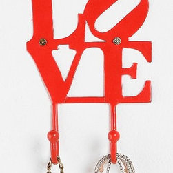 "Love Hook, Red - Robert Indiana's classic ""Love"" work gets updated here as a coat hook. It could be used for keys or jewelry."