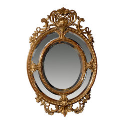 Oval Gilt Mirror - This rare beauty of a mirror is a work of art for your foyer or vanity area. The oval-gilded, hand-carved wooden frame is uniquely shaped around the gleaming glass. Bring French mid-19th-century style to your wall when you hang this stunning antique mirror.