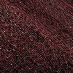 Arra Textured Upholstery Fabric in Burgundy - Arra Textured Upholstery Fabric in Burgundy is a nubby, textured weave with a rich color perfect for reupholstering furniture or throw pillows. The purple-red base of this fabric has silver threads woven throughout, creating a great texture. The perfect fabric to add a touch of decadence to interior designs. Made from a blend of 44% Polyester, 44% Acrylic, and 12% polypropylene. Passes NFPA 260 and 36,000 double rubs on the Wyzenbeek abrasion test. Width: 55″