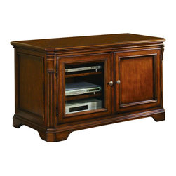 Hooker Furniture - Hooker Furniture Brookhaven 44in. TV Console - When you make the significant investment required for a plasma television, why not place it on one of these great consoles? The left door features interchangeable wood/glass panels and opens to reveal two adjustable shelves for components. Features: Material: Hardwood Solids with Cherry Veneers. Style: Traditional. Left door with interchangeable wood/glass panels and two adjustable shelves behind. Right door with wood panel, one adjustable shelf and one pullout shelf that takes VHS (including Disney) and audio tapes, CD's and DVD's. Three plug outlet. Levelers. Finished top. Finish: Distressed Medium Clear Cherry.
