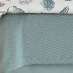 """Frontgate - Shoreline Coverlet - Duvet Cover has decorative fabrics on both sides. Ties inside all four corners for easy comforter attachment. Duvet Cover is made of 100% cotton. Reversible 100% cotton Coverlet features a herringbone pattern and 1"""" mitered hem around edge. Fully lined 100% cotton straight bedskirt has a 16"""" drop, 3"""" decking border, and split corners with kick pleats. Delightful summer days in sunny seaside resorts come alive with Shoreline. This marine pattern, in relaxed aquas and ivories, depicts shells and starfish. Whether onshore or deep inland, Shoreline takes its cool ambiance wherever it goes. .  .  .  .  . Shams include high-quality polyester fiber pillow insert; Euro and Boudoir shams have zipper closure for easy care . Boudoir sham features high-quality down pillow insert and zipper closure for easy care . Pairs with Tessa Sheeting . Because this bedding is specially made to order, please allow 4-6 weeks for delivery . Due to the handcrafted nature of the hand-painted pillow, slight imperfections and inconsistencies may occur . Dry clean; Coverlet only is washable . Made in USA ."""