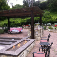 Traditional Fire Pits by Element Construction Masonry & Paving