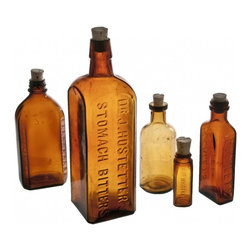 Amber Glass Bottles - vintage amber glass bottles including Ozomulsion, Milks Eemulsion, and one with graduated markings.