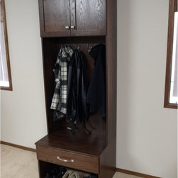 Dakota Handcrafters - Dakota Handcrafters Locker Hall Tree - 3084LS-02-BN - Shop for Caddies and Stands from Hayneedle.com! Entryway mud room or hallway clutter be gone! The Dakota Handcrafters Locker Hall Tree provides ample space for hanging coats storing shoes and putting away various other items that tend to collect in our most-trafficked areas. The upper cabinet has an adjustable shelf with seven holes enabling perfect placement for your storage needs. Holes at the back prevent the shelf from sagging. The bottom drawer features a full-extension under-mount glide and soft-close functionality. Four double-hook coat hooks provide plenty of space for your family s seasonal picks and guests coats too. Place your shoes and boots underneath and slip them on and off from the convenient bench seat.Four adjustable plastic feet on the base allow you to fine-tune their placement for uneven floors. The sides are flat so you can flush-mount additional hall trees for even more storage capability. Choose from the available color and hardware finish options to suit your home decor. This item comes fully assembled; simply remove it from its packaging and begin de-cluttering your space.About Dakota HandcraftersHandcrafted in Wallace S.D. Dakota Handcrafters products are instant heirlooms. Each piece is made with solid oak and maple wood cabinetry not particle board while drawers boast English dovetailing clear-coat finishes and precision ball-bearing guides. A superior seven-step hand-rubbed catalyzed varnish finish tops each classic.