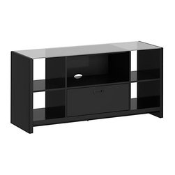 """kathy ireland Office - New York Skyline TV Stand (Modern Mocha) - Finish: Modern MochaIncludes Stabilibar TV safety brace. Wood hollow core frame for lightweight and sturdy construction. Painted wood finish with protective top coat. Attractive jeweled hardware. Frosted, tempered glass surface. One lateral file drawer. Quick-to-Assemble technology for dramatically reduced assembly time. Meets American National Standards Institute (ANSI) and Underwriters Laboratories (UL) standards. Warranty: 3 years. Made from durable hardwood solids. 61.58 in. W x 21.12 in. D x 30.24 in. HSafety features """"QTA"""" Quick to AssembleKathy Ireland Office by Bush Furniture brings the idea of a family work and play space to life with this TV credenza and lateral file. Your flat-panel TV (up to 60""""/117 lbs.) goes on top, while you can store papers in the lateral file. As always, safety comes first, with an included StabiliBar® TV Safety Brace and rounded corners and edges to reduce the risk of collision injuries. Glass surfaces are additionally reinforced with a safety brace and safety film to help prevent and protect against shattering injuries. Open storage spaces fit matching Kathy Ireland Office by Bush Furniture storage bins. All pieces are crafted with painted wood finish and a protective top coat. Features Bush Furniture's Quick-to-Assemble technology for dramatically reduced assembly time."""