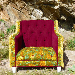 Retro Boho Tufted Floral Chair - The inside of this retro fabulous chair has been tufted in a warm vintage burgandy fabric.  The seat has a pop of vintage floral fabric in earth tone colors.  The arm panels have been covered in the same vintage floral fabric and flanked with a wonderfully funky gold fringe trim.  The outside back is also covered in the vintage floral and the chair terminates with white painted legs that pop against all these eclectic and cozy colors.