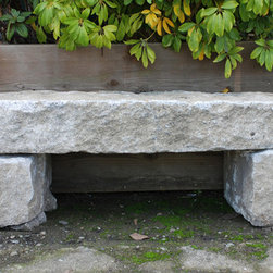 """Granite Curbstone Bench - Granite garden bench fashioned from reclaimed original street curb and sidewalk stones.    The bench consists of the seat slab plus two custom cut stone legs. San Francisco, California, early 20th century. Picture here is a 70"""" long x 17"""" deep x 18"""" tall version, but are available in a 4, 5, 6, 7 and 8 foot versions. Prices range from $630.00 for the four foot to $950.-- for the eight foot."""