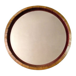 """Alpine Wine Design - Inverted Wine Barrel Mirror - Our Inverted Napa Valley Wine Barrel Mirror is created from the top of a wine barrel and features original metal bands and natural red wine stain. This one has the inside of the barrel featured, so you see lots of the wine stain surrounding the mirror. It's approximately 25"""" diameter x 4""""deep. Attaches to the wall with heavy duty hangers that are provided."""