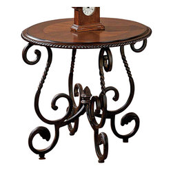 Steve Silver - Crowley End Table - Bring the unique look of  in. Old World in.  style into your home with the elegant Crowley End Table. This table adds the rustic, rich look of timeless Spanish and Mediterranean style to your decor. Pieces of the Crowley collection are heavily detailed with carved accents scalloped edges. The curved base supports a beautiful inlayed table top.