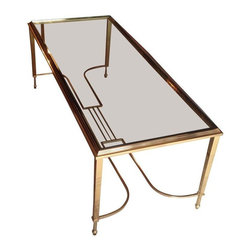Brass Antique Coffee Table - This brass coffee table is an antique reproduction. Art deco details and a lovely glass top, this piece is sure to glam up any room!