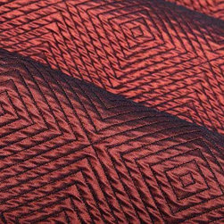Impulse Geometric Upholstery Fabric in Wine - Impulse Geometric Upholstery Fabric in Wine has a red diamond pattern with a slight sheen that gives a metallic look. Ideal for upholstering sofas, chairs, and ottomans or for creating custom bedding and pillows. Made in the USA from a blend of 18% cotton, 32% olefin, and 50% polyester. This upholstery fabric passes 30,000+ double rubs on the Wyzenbeek Abrasion Test. Passes CA117 Test, UFAC 1 Width 53″; Repeat: 5 3/4″ H; 5″V