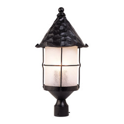 Elk - Rustica 3-Light Outdoor Post Light in Matte Black with Scavo Glass - Bring storybook flair to an old English, cottage or Spanish revival-style home with the rustica collection. Hand-hammered iron and scavo seedy-glass cylinders characterize this series, which may be ordered in matte black (Bk) with white scavo glass and antique copper (Ac) with amber scavo glass. They may be used in both indoor and outdoor locations. (Ul Listed).