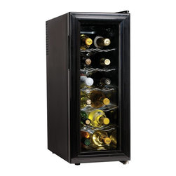 Koolatron - 12 Bottle Slim Countertop Wine Cellar - Even when space is tight, you can enjoy perfectly chilled wine. Our countertop unit is a slim-line cooler that protects the quality of reds and brings whites to a perfect serving temperature. With thermoelectric cooling, this unit prevents vibration and operates quietly, too. Flush back design. Double tempered glass door. Adjustable temperature control. Advanced heat dissipation system. Quiet, energy-efficient operation. No compressor, no vibration. Holds atleast 12 bottles of wine. 11.7 in. L x 20.8 in. W x 26 in. H (35 lbs.). 12 Bottle Wine Cellar ManualThis 12 Bottle Thermoelectric Wine Cooler fits in many places that most other wine coolers won't. This compact wine cooler measures just over 11 inches wide, but it still manages to hold up to 12 bottles of wine in perfect conditions. Plus, it uses a thermoelectric cooling unit, so there is no vibration to disturb the sediment in your fine wines. For compact wine cooling, this wine cooler is perfect! Adjustable thermostat Lock Thermoelectric solid-state cooling- no vibration to disturb bottle sediments Auto defrost Soft interior lighting with on/off switch. Pro-style handle Thermopane reversible glass door Freestanding design Slide-out chrome shelves.