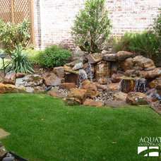 Traditional Landscape by AquaTerra Outdoors