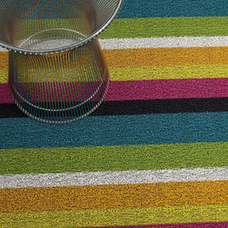 Bold Stripe Shag Mat, Multi - A riot of playful colors make up this utility mat. I love the bright-on-bright combination. It would make a rainy day not so gray and cloudy.