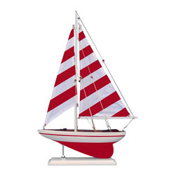Handcrafted Nautical Decor - Red Striped Pacific Sailer 25'' - NOT A MODEL SHIP KIT   --Attach Sails and this Sailboat Centerpiece is Ready for Immediate Display ---- --Brighten  your day, or any room of your home, with   this delightfully fun  Pacific Sailboat model. Perfect nautical Decor gifts for friends,    children, or party guests, they also make excellent nautical decorations  or sailboat centerpieces for a reception or group event. Liven your  office, beach   house, or sunroom with one of these colorful sailboat  models today! --------    Handcrafted solid wood hull, masts and stand with metal supports--    Timeless nautical colors - Red and white--    Largest sailboat selection available - We offer over 150 unique model sailboats --    Featured in Sept 2011 Brides magazine - Excellent wedding table centerpiece--    --    Perfect nautical gift for friends, children or party guests--    --    Ideal for banquets, receptions, meetings, or any other nautical party or event ---- Contact us for quantity discounts---- --This model sailboat requires minor assembly. Simply insert mast into hull and clip on the sails. --There is no rigging to tie or tighten. Assembly takes less than 2 minutes.