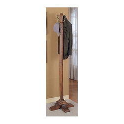 Powell Furniture - Wood Coat Rack in Woodbury Mahogany Finish - Solid crafting is enhanced with acanthus carvings and a stepped base on the Woodbury mahogany coat rack.  It's a recommended addition for office entries and in home foyers.  The sheen of this fine hardwood is a timeless classic for any decor. * Will complement any home decor. 4 Large hooks for handing coats, scarves and hats. Post is supported by 4 feet that lead into a stepped base. Heavy select hardwood post and base of this coat rack and accented with hand-carved with shells and acanthus leaves. 19 in. L x 19 in. W x 72 in. H