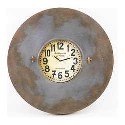 "Paris Wall Clock W/ Magnets Small - This charming wall clock celebrates the beauty in antiquity (or Antiquité de Paris, as featured on the face). You can use the fleur-de-lis-shaped magnets to keep reminders (""Book trip to Paris!"") on its metal surface."