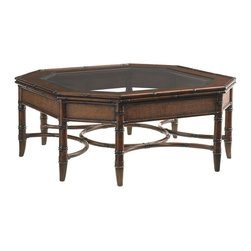 Lexington - Lexington Landara Marianas Cocktail Table 545-947 - Carved rattan trimmed wood gracefully frame the beveled glass top, revealing the elegant leather strapped rattan stretcher below. Woven raffia panels and antique brass finished ferrules create a sophisticated look.