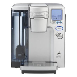 Cuisinart® Single Serve Coffee Maker - This state-of-the-art coffee maker combines Cuisinart and Keurig technology for the ultimate in one-cup convenience. Ideal for personal use or entertaining, single K-Cup servings of gourmet coffee, tea or cocoa (over 200 varieties) are ready with one touch in less than a minute, at your preferred strength and without any measuring or mess. Fully programmable machine offers the full spectrum of features, including adjustable temperature control and auto on/off. Five cup sizes include an iced beverage setting; drip tray is removable to accommodate taller travel mugs. Reusable, self-storing My K-Cup filter allows use with any ground coffee. Extra-large water reservoir reduces refills. Rinse control instantly cleans the chamber so every cup maintains its unique flavor; hot water button lets you enjoy your favorite instant coffee or tea, soup or cocoa.