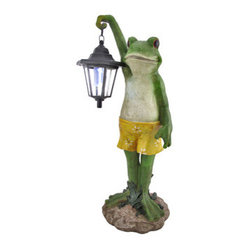 Outdoor Frog with Lantern Solar Light Garden Accent - Add a whimsical accent to your garden, path, or doorstep with this outdoor statue. It features a funny frog, hanging out in his bathing suit, holding a lantern to shed some light on the situation. Made of cold cast resin, it measures 20 1/2 inches tall, 10 1/2 inches wide, and 7 1/2 inches deep. Three small solar panels charge the 6 1/2 inch lantern all day, and there is an on/off switch so you can control the light. This outdoor statue makes a great housewarming gift for frog collectors, and is sure to be admired.