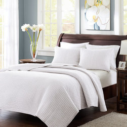 White Stripe Quilted Coverlet Set - I've really grown to love white bedding because it is so versatile. Use it as the backdrop for a luxurious bed, and then pile on the pillows in striking prints.