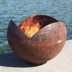 The Firefly Firebowl - I love this firepit because it takes an industrial material like steel, shapes it into a tulip opening and adds fire. What a great combination for an eye-catching scene.