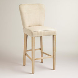 World Market - Linen Barrel Barstools, Set of 2 - Crafted of rubberwood with natural linen upholstery, our exclusive Linen Barrel Barstools are incredibly versatile. Embellished with tiny nail head details and baseball stitching, this pair of neutral stools makes a sophisticated seating solution.