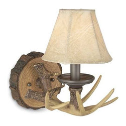 Craftmade Lighting - Single-Light Antler Sconce - 19406EB1 - Bring the wild outdoors inside with this single-light antler sconce. A simulated deer antler projects from a simulated log cut-out with a faux-leather shade adorning the top. This whimsical light is perfect for that mountain cabin or country estate, but can be placed anywhere in need of a little rustic appeal. Includes a pin-up kit with eight feet of plug-in cord and an on/off inline switch. Takes (1) 60-watt incandescent Flame bulb(s). Bulb(s) sold separately. Dry location rated. Fixture is plug-in and comes with cord and plug.
