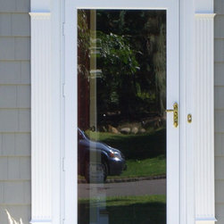 Storm Doors - This storm door demonstrates how a fullview glass panel can really open up your foyer by letting the sun in, with your entry door open.
