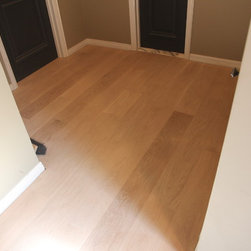 "Residential remodel - Beverly Hills - Unfinished solid 7"" oak second floor common area. After installation and sanding."
