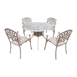 Oakland Living - 5-Pc Handcast Dinning Set in Antique Bronze F - Includes capital table, four stackable chairs and metal hardware. Traditional lattice pattern with scroll work. Hardened powder coat. Fade, chip and crack resistant. Warranty: One year limited. Made from rust free cast aluminum. Minimal assembly required. Table: 48 in. Dia. x 29 in. H. Chair: 23 in. W x 22 in. D x 35.5 in. H (25 lbs.)The Oakland Mississippi collection combines grace style and modern designs giving you a rich addition to any outdoor setting. We recommend that the products be covered to protect them when not in use. To preserve the beauty and finish of the metal products, we recommend applying an epoxy clear coat once a year. However, because of the nature of iron it will eventually rust when exposed to the elements.
