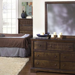 Progressive Furniture Casual Traditions 7 Drawer Dresser - Walnut - Casual, traditional, and inviting, the Progressive Furniture Casual Traditions 7 Drawer Dresser - Walnut features Shaker-influenced overlays that present a relaxed, unpretentious style. Its splayed legs, wood-on-wood drawer guides, and wooden hardware are enhanced by a warm espresso finish, making this dresser a perfect addition to almost any bedroom decor.About Progressive FurnitureEstablished in 1985 in Hickory, North Carolina by several investors who had a vision to shape a successful furniture company, Progressive Furniture has thrived ever since. They began manufacturing and distributing occasional tables and naturally started creating bedroom furniture. By 2001, Progressive furniture had become a major force in U.S. furniture manufacturing covering the likes of several markets including: occasional tables, bedroom furniture, entertainment centers, and dining room furniture. Around that same time, Progressive Furniture was acquired by Sauder Woodworking and became a part of the Sauder family of companies. Together, they soon became the 7th largest furniture manufacturing company in the world. Today, Sauder and Progressive operate facilities in Ohio, North Carolina, California, Mexico, and China, including additional partnerships with factories in Indonesia, Vietnam, and Hong Kong. Progressive remains at the top of the industry and has been a trusted manufacturer for over 25 years.