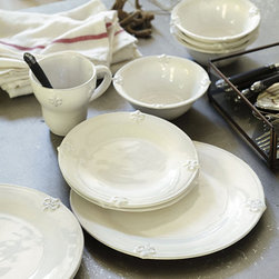 16-Piece Fleur de Lis Set - This stoneware embossed with a fleur-de-lis pattern is casual, everyday ware with a little French touch.