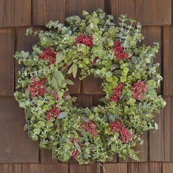 Live Eucalyptus & Red Berry Wreath - Are you decorating with red this year? I adore the tiny hint of red with the berries in this wreath. It is subtle and would be beautiful on outdoor windows or on an interior door. I would also consider hanging this on a headboard. It's so pretty.