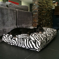 Frontgate - Animals Matter Pet Floor Pillow Dog Bed - Covered in padded, textured micro-velvet. Upholstery-grade memory-spring poly fiberfill. Removable cover zips off. Machine wash; cool or line dry. Available in Cow Hide (Black and Brown) and Zebra. The Animals Matter Pet Floor Pillow provides cushiony comfort for your dog to stretch out and relax. Stuffed with upholstery-grade, memory-spring poly fiberfill, this bed is covered in padded, textured micro-velvet performance fabric that is both luxurious and longwearing.  .  .  .  .  . Made in the USA.