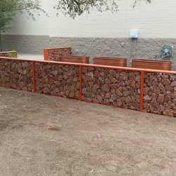 ECO-ROCK™ Wall Systems - Canyon View Elementary School in Tuscon, AZ, utilizes ECO-ROCK™ to create a natural fence around an area where children have plants growing.