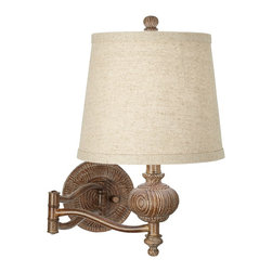"""Kathy Ireland - Country - Cottage Kathy Ireland Grand Maison 17"""" High Swing Arm Wall Lamp - For the country decor enthusiast this Grand Maison swing arm wall lamp comes from the inspiring Kathy Ireland Home collection. The design features an ornate carved look in a weathered woodland finish and a light tapered shade up top that is held in place by a round decorative finial. A generous 26"""" arm extension lets you position the light exactly where you need it whether that is next to a bed or above your favorite reading spot. Easy to install this design plugs into any standard outlet. Swing arm wall lamp. Weathered woodland finish. Ornate carved look. Takes one 100 watt medium base bulb (not included). Plugs into any standard outlet. 17"""" high. 26"""" arm extension. Shade is 8"""" across the top 10"""" across the bottom 8 1/2"""" high.  Swing arm wall lamp.  Weathered woodland finish.  Ornate carved look.  Takes one 100 watt medium base bulb (not included).  Plugs into any standard outlet.  17"""" high.  26"""" arm extension.  Shade is 8"""" across the top 10"""" across the bottom 8 1/2"""" high."""